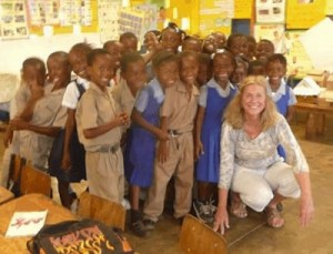 Jamaica Project leader, Pam, with Mason Hall school kids